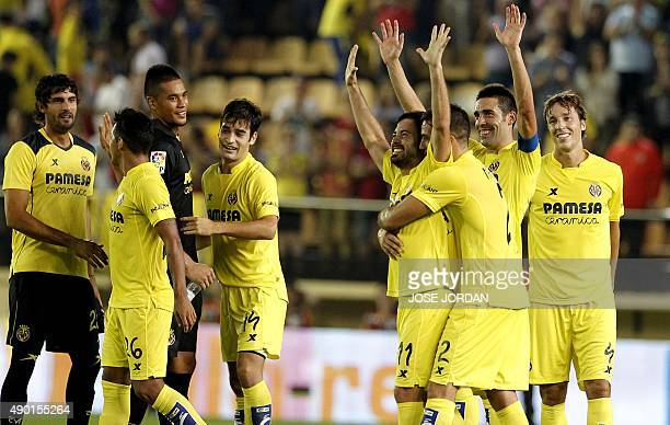 Villarreal's players celebrate their victory during the Spanish league football match Villarreal CF vs Club Atletico de Madrid at El Madrigal stadium...