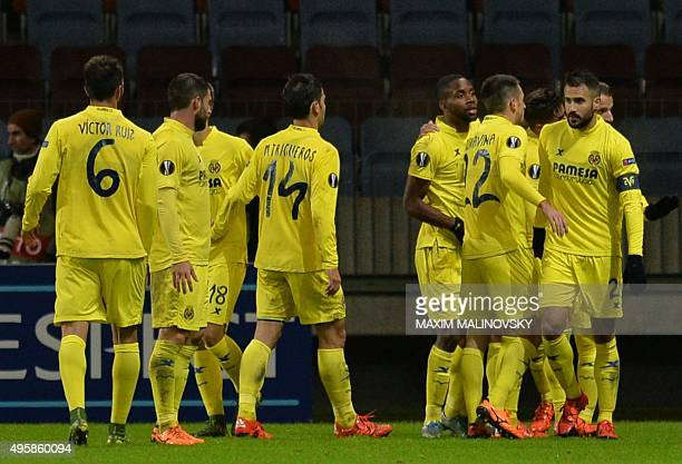 Villarreal's players celebrate their victory over Dinamo Minsk after the UEFA Europa League group E football match between FC Dinamo Minsk and...