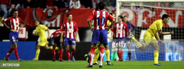 Villarreal´s Roman Riquelme celebrates the goal 30 October 2005 in Madrid in front of Atletico de Madrid´s Kedman during their Spanish League...