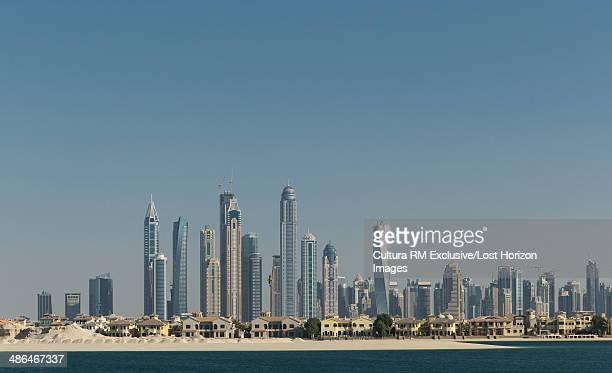 Villas on Palm Island and modern skyscrapers in Dubai Marina