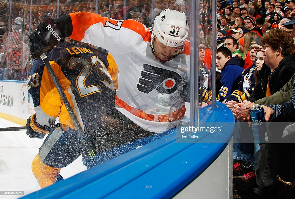 Ville Leino of the Buffalo Sabres and Jay Rosehill of the Philadelphia Flyers battle for the puck in the corner on January 14 2014 at the First...