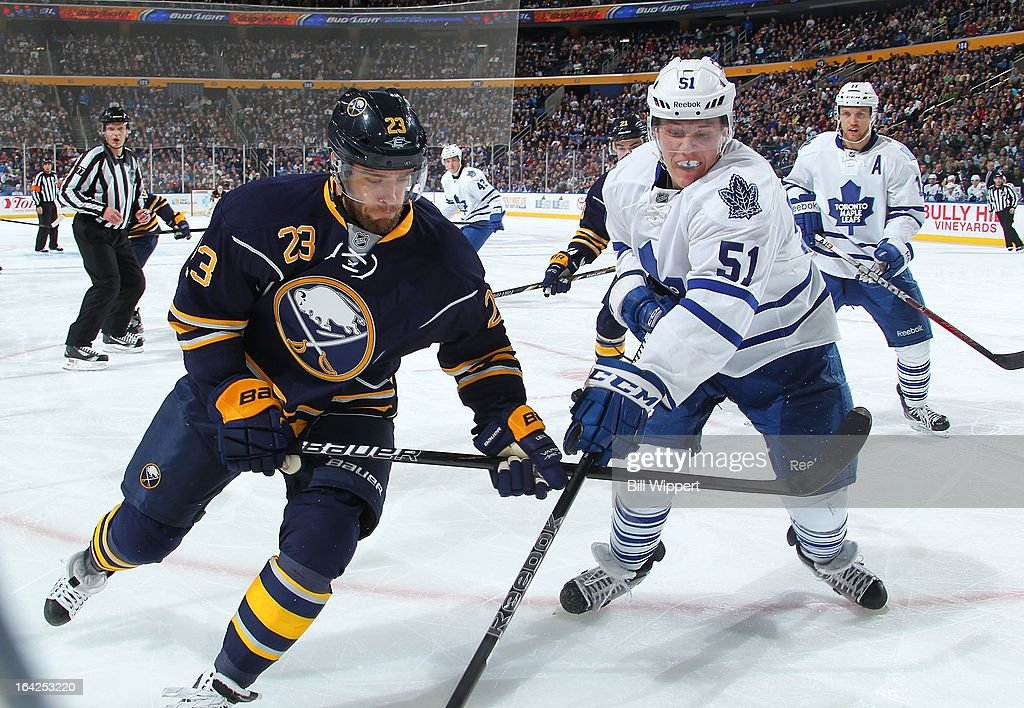 <a gi-track='captionPersonalityLinkClicked' href=/galleries/search?phrase=Ville+Leino&family=editorial&specificpeople=4025199 ng-click='$event.stopPropagation()'>Ville Leino</a> #23 of the Buffalo Sabres battles for the puck against Jake Gardiner #51 of the Toronto Maple Leafs on March 21, 2013 at the First Niagara Center in Buffalo, New York. Buffalo defeated Toronto, 5-4.