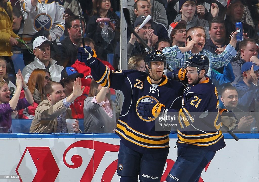 <a gi-track='captionPersonalityLinkClicked' href=/galleries/search?phrase=Ville+Leino&family=editorial&specificpeople=4025199 ng-click='$event.stopPropagation()'>Ville Leino</a> #23 of the Buffalo Sabres celebrates his second goal of the game with teammate <a gi-track='captionPersonalityLinkClicked' href=/galleries/search?phrase=Drew+Stafford&family=editorial&specificpeople=220617 ng-click='$event.stopPropagation()'>Drew Stafford</a> #21 in their game against the Washington Capitals on March 30, 2013 at the First Niagara Center in Buffalo, New York.