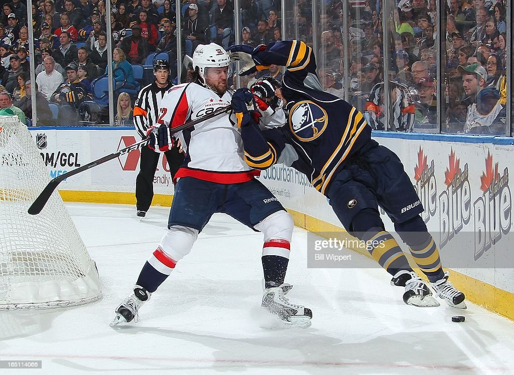 <a gi-track='captionPersonalityLinkClicked' href=/galleries/search?phrase=Ville+Leino&family=editorial&specificpeople=4025199 ng-click='$event.stopPropagation()'>Ville Leino</a> #23 of the Buffalo Sabres gets tangled up with Mike Green #52 of the Washington Capitals on March 30, 2013 at the First Niagara Center in Buffalo, New York. Washington defeated Buffalo, 4-3.