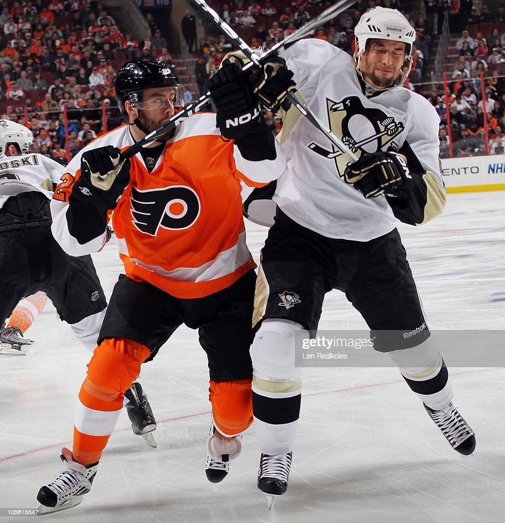 Ville Leino #22 of the Philadelphia Flyers battles for position with Deryk Engelland #5 of the Pittsburgh Penguins on October 16, 2010 at the Wells Fargo Center in Philadelphia, Pennsylvania.