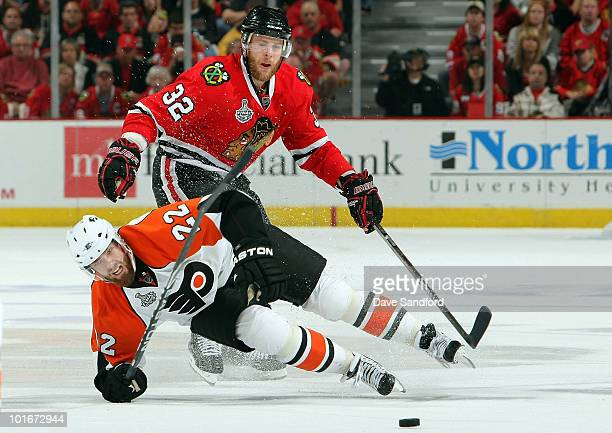 Ville Leino of the Philadelphia Flyers falls to the ice in front of Kris Versteeg of the Chicago Blackhawks during the second period of Game Five of...