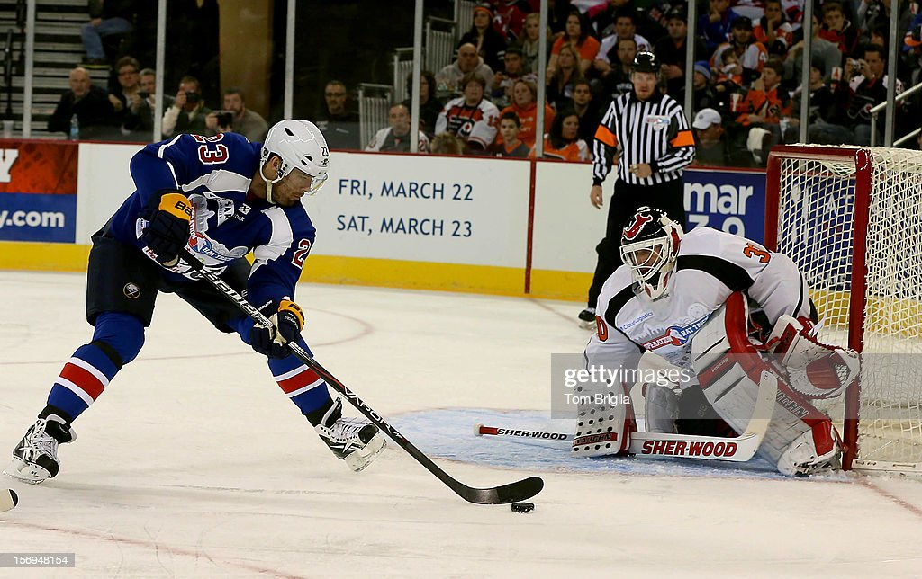 <a gi-track='captionPersonalityLinkClicked' href=/galleries/search?phrase=Ville+Leino&family=editorial&specificpeople=4025199 ng-click='$event.stopPropagation()'>Ville Leino</a> #23 takes a shot on <a gi-track='captionPersonalityLinkClicked' href=/galleries/search?phrase=Martin+Brodeur&family=editorial&specificpeople=201594 ng-click='$event.stopPropagation()'>Martin Brodeur</a> #30 during Operation Hat Trick Benefit Exhibition Hockey Game at Boardwalk Hall Arena on November 24, 2012 in Atlantic City, New Jersey.