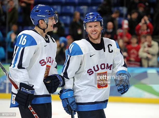 Ville Peltonen and Saku Koivu of Finland celebrate after their 20 win during the ice hockey men's quarter final game between Finland and the Czech...