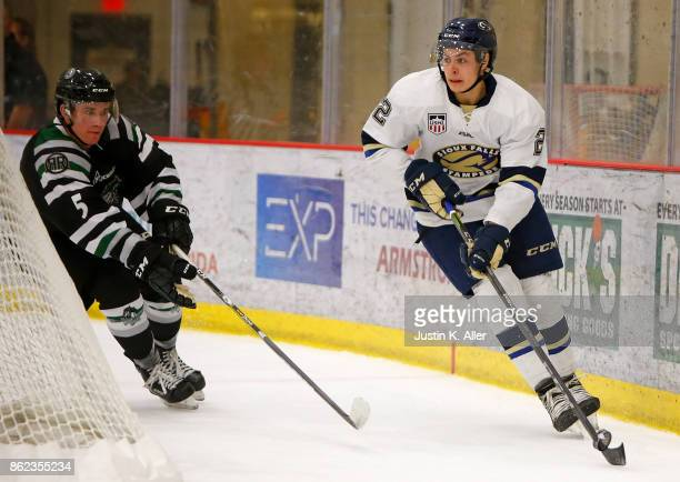 Villella of the Sioux Falls Stampede handles the puck against Chase Blackmun of the Cedar Rapids RoughRiders during the game on Day 2 of the USHL...