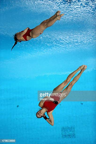 Villo Kormos and Zsofia Reisinger of Hungary dive in the Women's 10m Synchro Platform Final during day one of the FINA/NVA Diving World Series 2014...