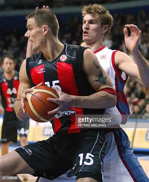 Lietuvos Rytas' Lithuanian center Javtokas Robertas protects the ball from Tau Ceramica's Spanish center Tiago Splitter during their EuroLeague...