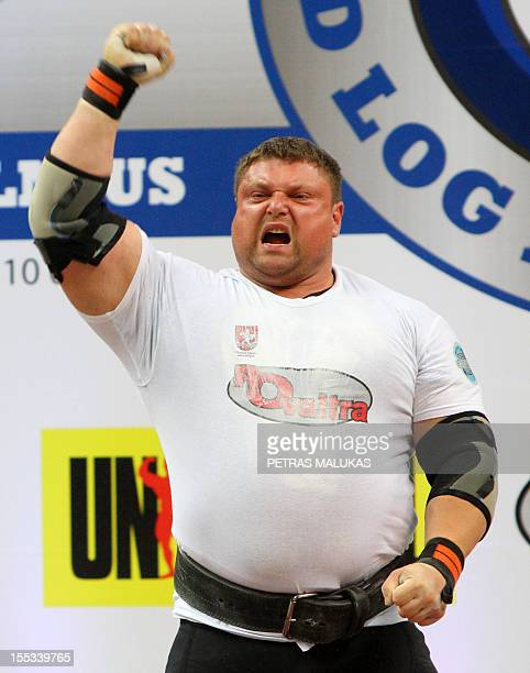 TO GO WITH AFP STORY BY VAIDOTAS BENIUSIS Powerlifter and professional strongman Zydrunas Savickas gestures as he wins the 2012 World Log Lift...