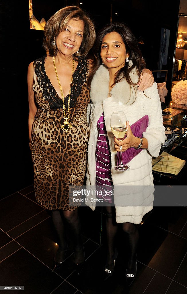 Vimla Lalvani (L) and Divia Lalvani attend the ESCADA/Harper's Bazaar book reading with Fatima Bhutto, reading from her novel 'The Shadow Of The Crescent Moon', at the ESCADA Knightbridge boutique on December 11, 2013 in London, England.