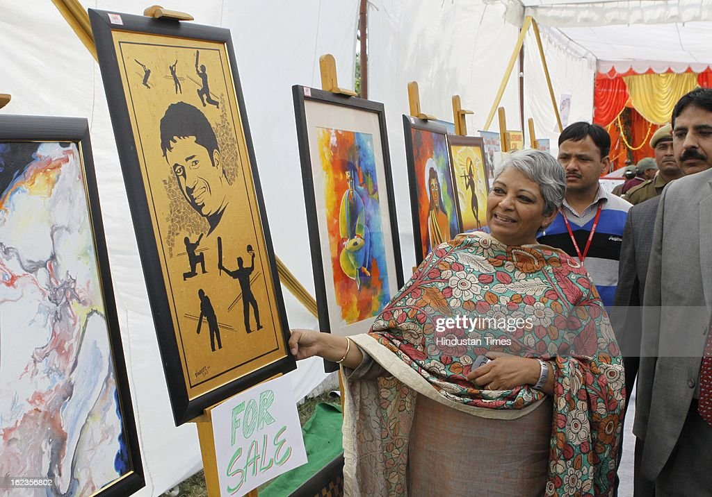 Vimla Mehra DG Tihar apriciates the paintings made by Tihar inmates at Tihar Jail, during the Annual Press Conference at Tihar Jail on February 22, 2013 in New Delhi, India.