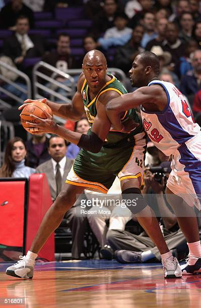 Vin Baker of the Seattle SuperSonics is defended by Elton Brand of the Los Angeles Clippers during the game at Staples Center in Los Angeles...