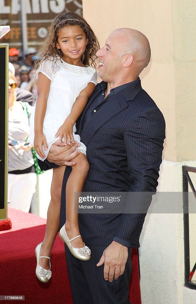 <a gi-track='captionPersonalityLinkClicked' href=/galleries/search?phrase=Vin+Diesel&family=editorial&specificpeople=171983 ng-click='$event.stopPropagation()'>Vin Diesel</a> and daughter, Hania Riley attend the ceremony honoring him with a Star on The Hollywood Walk of Fame held on August 26, 2013 in Hollywood, California.