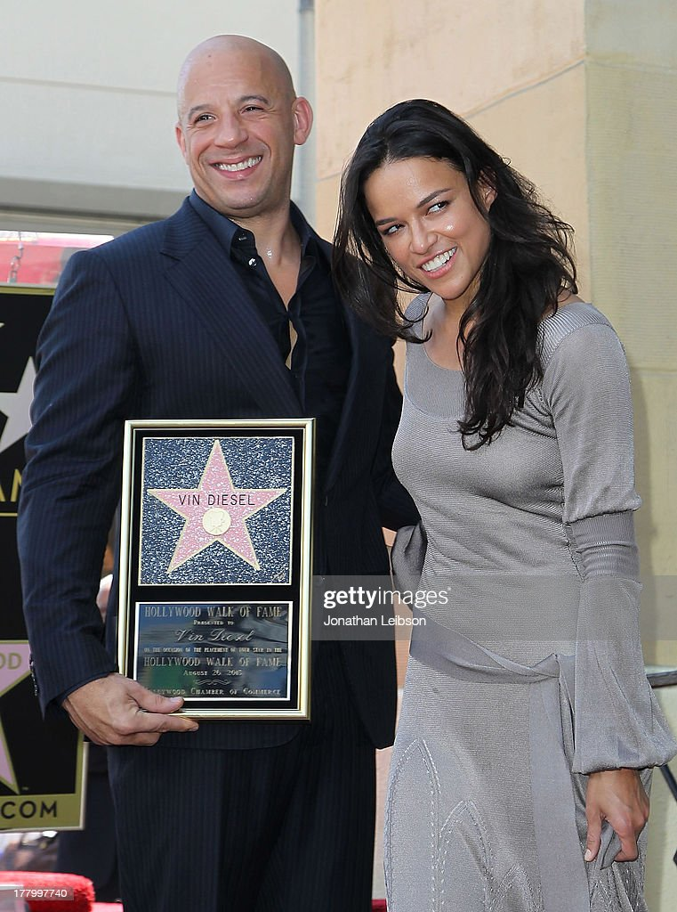 <a gi-track='captionPersonalityLinkClicked' href=/galleries/search?phrase=Vin+Diesel&family=editorial&specificpeople=171983 ng-click='$event.stopPropagation()'>Vin Diesel</a> and <a gi-track='captionPersonalityLinkClicked' href=/galleries/search?phrase=Michelle+Rodriguez&family=editorial&specificpeople=206182 ng-click='$event.stopPropagation()'>Michelle Rodriguez</a> attend the ceremony honoring <a gi-track='captionPersonalityLinkClicked' href=/galleries/search?phrase=Vin+Diesel&family=editorial&specificpeople=171983 ng-click='$event.stopPropagation()'>Vin Diesel</a> with a star on The Hollywood Walk of Fame held on August 26, 2013 in Hollywood, California.