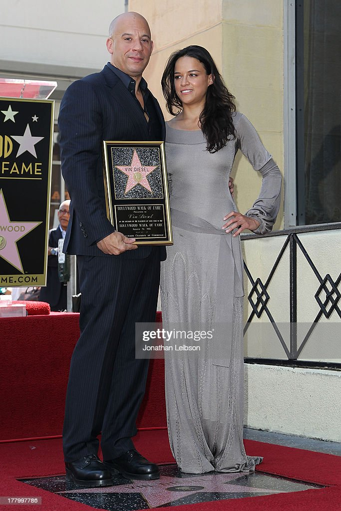 Vin Diesel and Michelle Rodriguez attend the ceremony honoring Vin Diesel with a star on The Hollywood Walk of Fame held on August 26, 2013 in Hollywood, California.