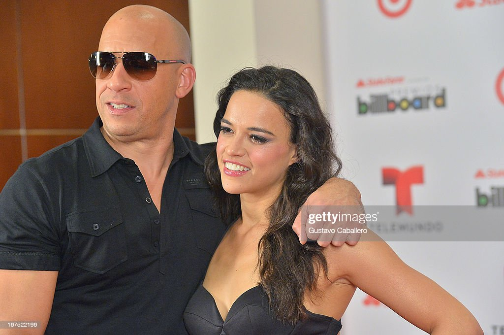 <a gi-track='captionPersonalityLinkClicked' href=/galleries/search?phrase=Vin+Diesel&family=editorial&specificpeople=171983 ng-click='$event.stopPropagation()'>Vin Diesel</a> and <a gi-track='captionPersonalityLinkClicked' href=/galleries/search?phrase=Michelle+Rodriguez&family=editorial&specificpeople=206182 ng-click='$event.stopPropagation()'>Michelle Rodriguez</a> pose backstage at Billboard Latin Music Awards 2013 at Bank United Center on April 25, 2013 in Miami, Florida.