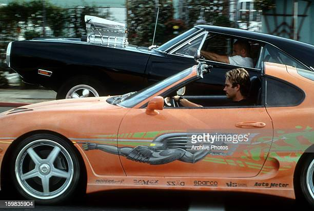 Vin Diesel and Paul Walker racing against each other in a scene from the film 'The Fast And The Furious' 2001