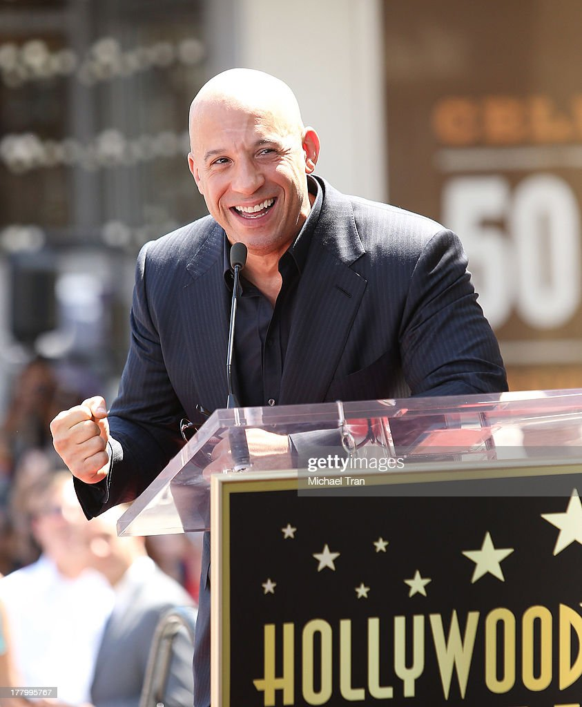 <a gi-track='captionPersonalityLinkClicked' href=/galleries/search?phrase=Vin+Diesel&family=editorial&specificpeople=171983 ng-click='$event.stopPropagation()'>Vin Diesel</a> attends the ceremony honoring him with a Star on The Hollywood Walk of Fame held on August 26, 2013 in Hollywood, California.