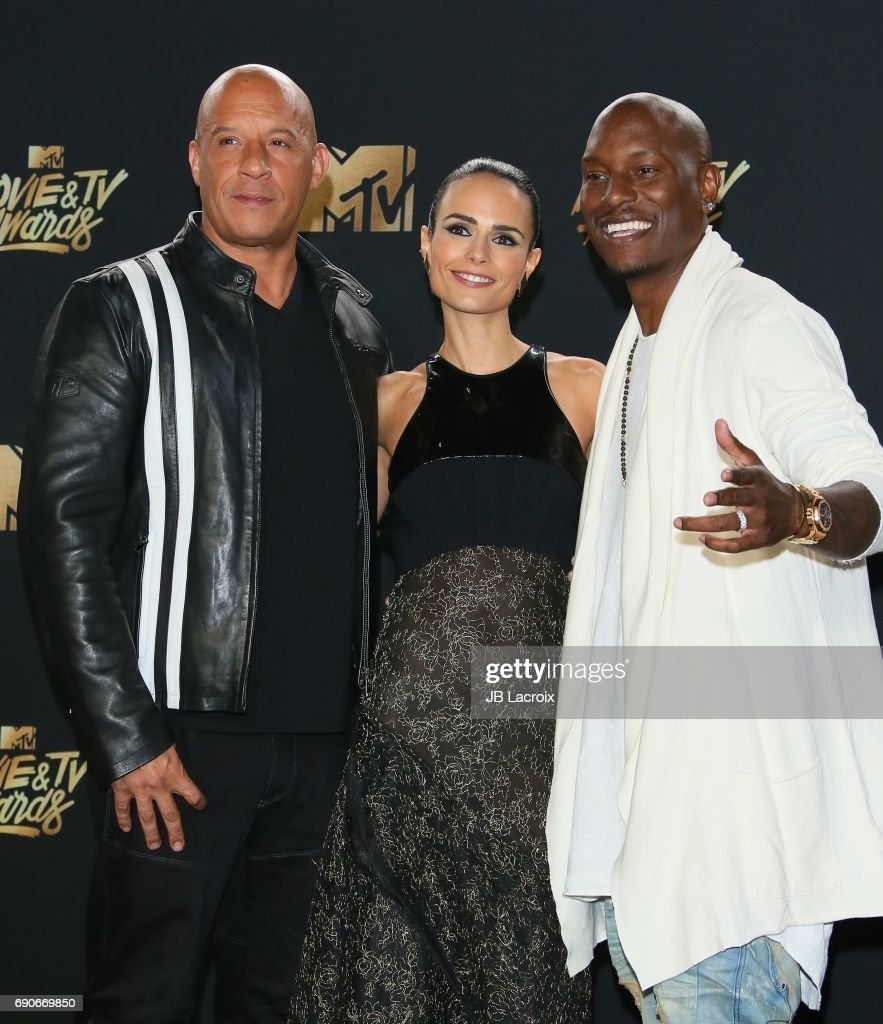Vin Diesel; Jordana Brewster; Tyrese Gibson pose in the press room at the 2017 MTV Movie and TV Awards at The Shrine Auditorium on May 7, 2017 in Los Angeles, California.