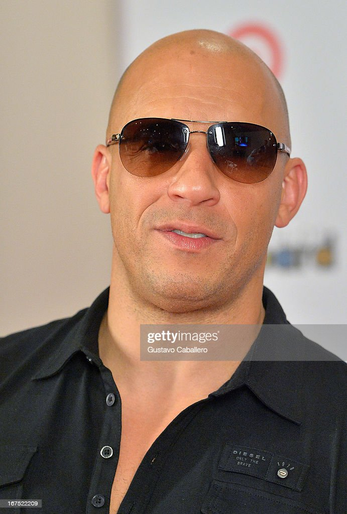 <a gi-track='captionPersonalityLinkClicked' href=/galleries/search?phrase=Vin+Diesel&family=editorial&specificpeople=171983 ng-click='$event.stopPropagation()'>Vin Diesel</a> pose backstage at Billboard Latin Music Awards 2013 at Bank United Center on April 25, 2013 in Miami, Florida.