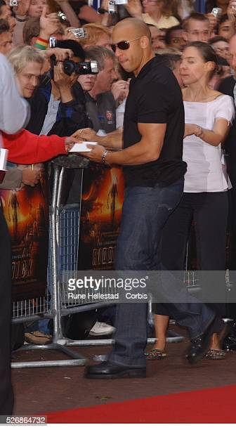 Vin Diesel signs autographs for his fans at the premiere of 'The Chronicles of Riddick' at Vue Cinema Leicester Square