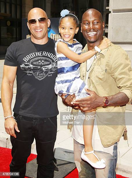 Vin Diesel with Tyrese Gibson and his daughter Shayla Somer attend the 'Fast Furious Supercharged' ride press launch event held at Universal Studios...