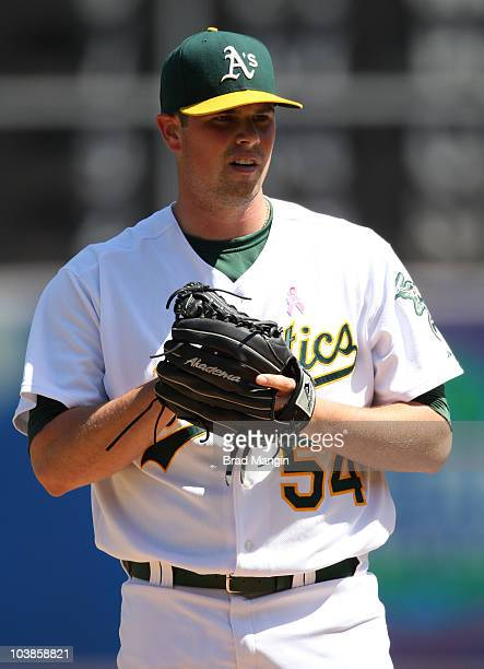 Vin Mazzaro of the Oakland Athletics pitches against the Los Angeles Angels of Anaheim during the game at the OaklandAlameda County Coliseum on...