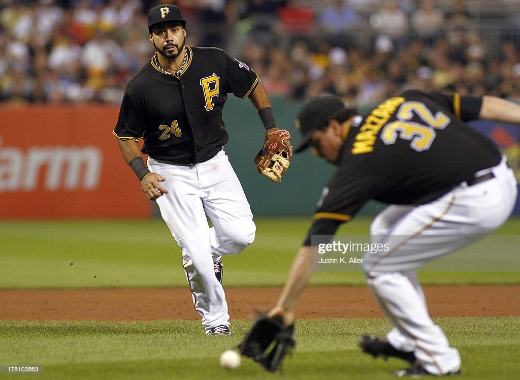 <a gi-track='captionPersonalityLinkClicked' href=/galleries/search?phrase=Vin+Mazzaro&family=editorial&specificpeople=5759050 ng-click='$event.stopPropagation()'>Vin Mazzaro</a> #32 of the Pittsburgh Pirates fields a ground ball as Pedro Alvarez #24 looks on against the St. Louis Cardinals during the game on July 31, 2013 at PNC Park in Pittsburgh, Pennsylvania.