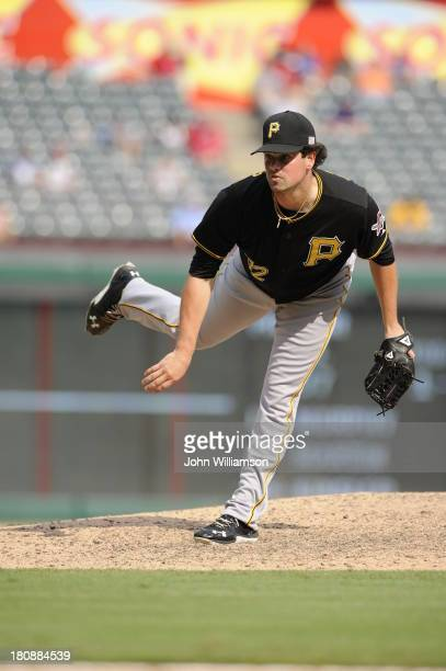 Vin Mazzaro of the Pittsburgh Pirates pitches against the Texas Rangers at Rangers Ballpark on September 11 2013 in Arlington Texas The Pittsburgh...