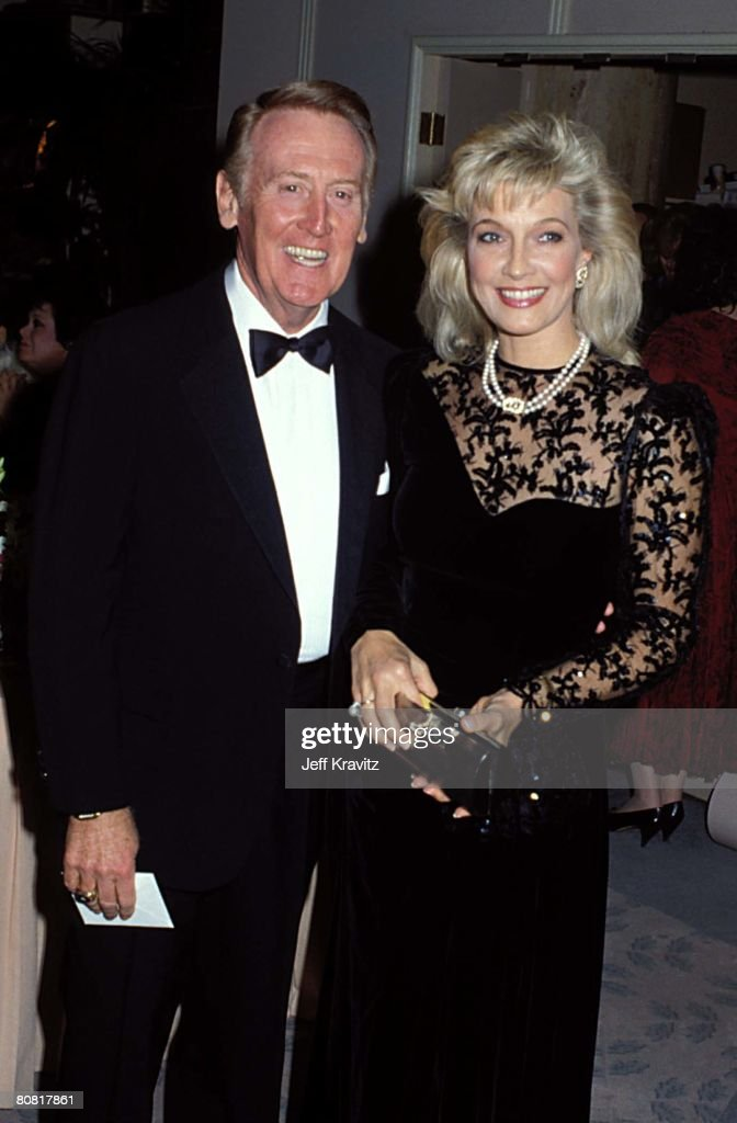 <a gi-track='captionPersonalityLinkClicked' href=/galleries/search?phrase=Vin+Scully&family=editorial&specificpeople=878517 ng-click='$event.stopPropagation()'>Vin Scully</a>