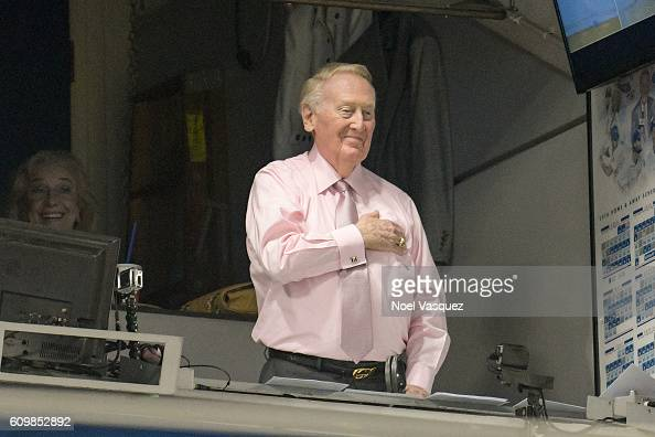 Vin Scully salutes prior to a baseball game between the Colorado Rockies and the Los Angeles Dodgers at Dodger Stadium on September 22 2016 in Los...