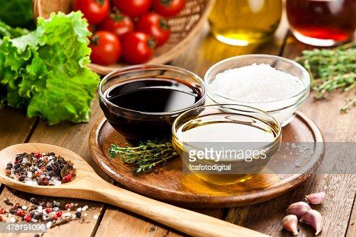 Vinaigrette ingredients on rustic wood table