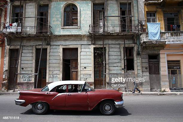 A vinatge American car is driven past colonial era buildings on September 17 2015 in Havana Cuba Pope Francis is due to make a three day visit to...