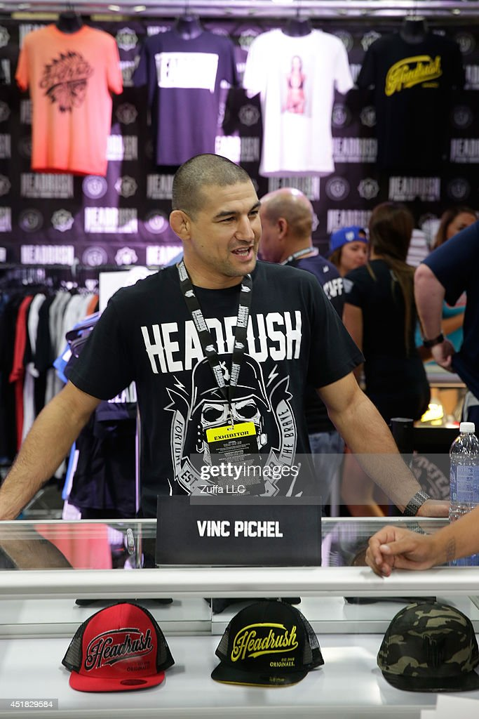 Vinc Pichel signs autographs for fans during the UFC Fan Expo 2014 during UFC International Fight Week at the Mandalay Bay Convention Center on July...