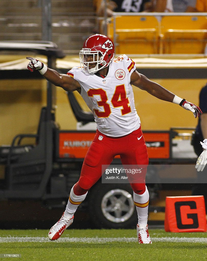 Vince Agnew #34 of the Kansas City Chiefs celebrates after running back a kickoff for a touchdown one hundred nine yards against the Pittsburgh Steelers in the second half during the game on August 24, 2013 at Heinz Field in Pittsburgh, Pennsylvania.