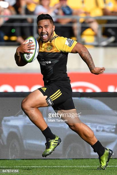 Vince Aso of the Hurricanes breaks to score during the round two Super Rugby match between the Hurricanes and the Rebels at Westpac Stadium on March...
