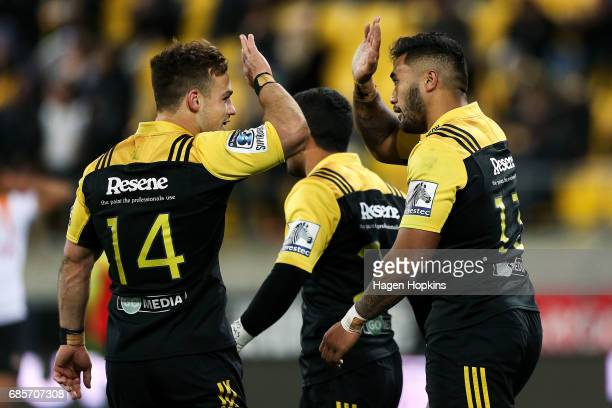 Vince Aso of the Hurricanes celebrates his try with Wes Goosen during the round 13 Super Rugby match between the Hurricanes and the Cheetahs at...