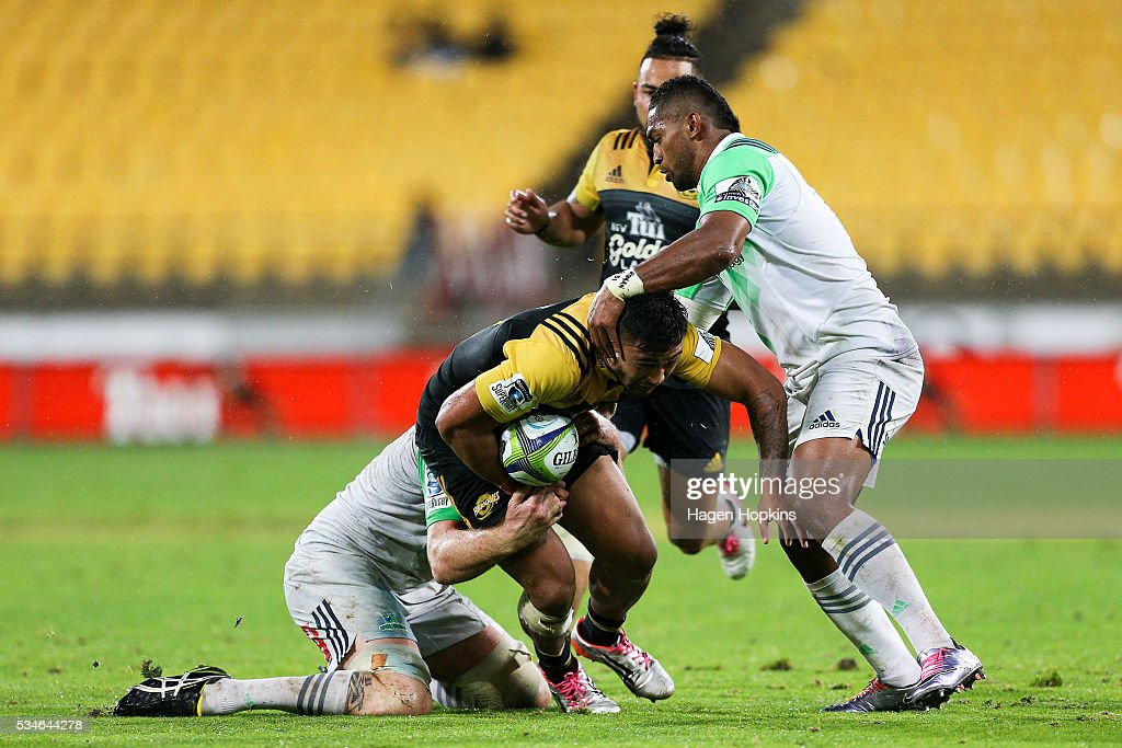 Vince Aso of the Hurricanes is tackled by Waisake Naholo of the Highlanders during the round 14 Super Rugby match between the Hurricanes and the Highlanders at Westpac Stadium on May 27, 2016 in Wellington, New Zealand.