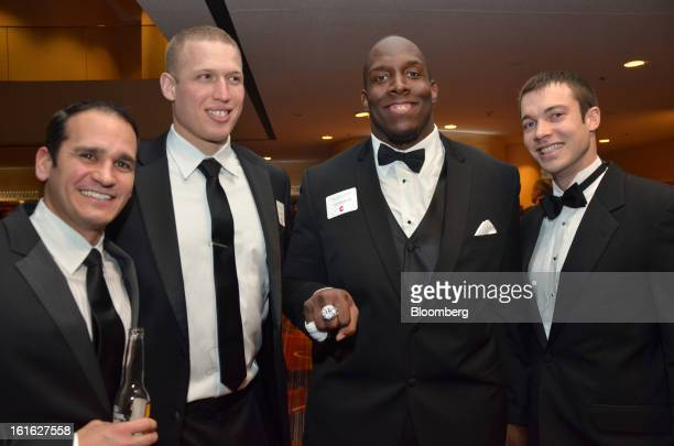 Vince Bates from left Joel Sussman Kevin Boothe and Chad Nice who played football for Cornell gather for a group portrait during the Ivy Football...