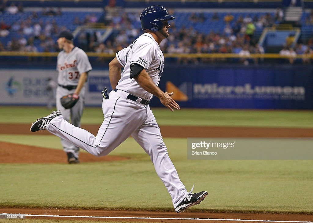 Vince Belnome #30 of the Tampa Bay Rays sprints down the third base line to score on a single by Ben Zobrist during the second inning of a game against the Detroit Tigers on August 19, 2014 at Tropicana Field in St. Petersburg, Florida.