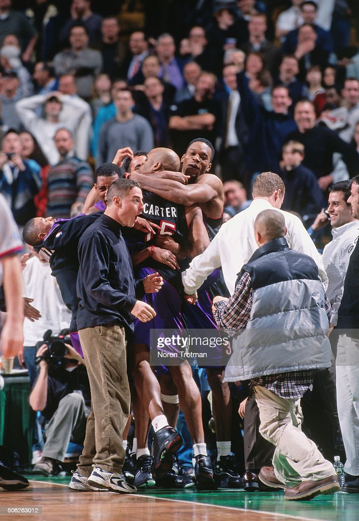 Vince Carter and Antonio Davis of the Toronto Raptors celebrates against the Boston Celtics on March 1 2000 at the Fleet Center in Boston...