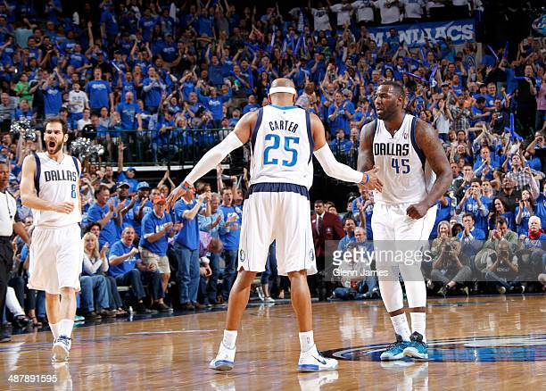 Vince Carter and DeJuan Blair of the Dallas Mavericks celebrate a win against the San Antonio Spurs in Game Six of the Western Conference...