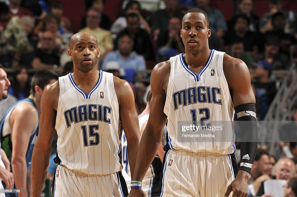 Vince Carter #15 and Dwight Howard #12 of the Orlando Magic react during the game against the Minnesota Timberwolves on March 26, 2010 at Amway Arena in Orlando, Florida.