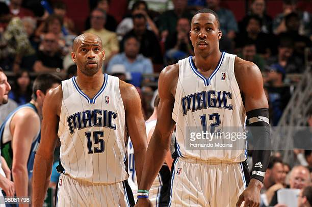 Vince Carter and Dwight Howard of the Orlando Magic react during the game against the Minnesota Timberwolves on March 26 2010 at Amway Arena in...