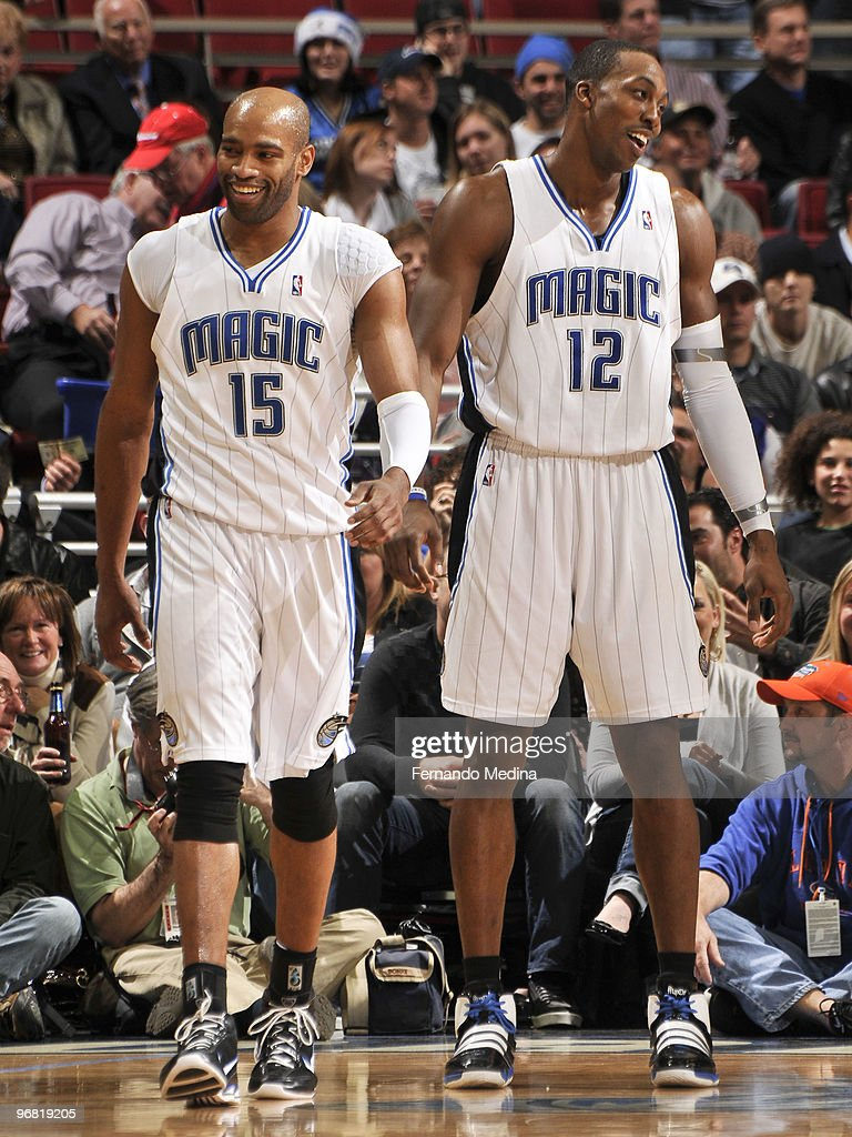 Vince Carter #15 and Dwight Howard #12 of the Orlando Magic react with smiles during the game against the Detroit Pistons on February 17, 2010 at Amway Arena in Orlando, Florida.
