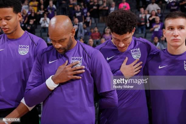 Vince Carter and Justin Jackson of the Sacramento Kings line up for the National anthem of the game against the San Antonio Spurs on October 2 2017...