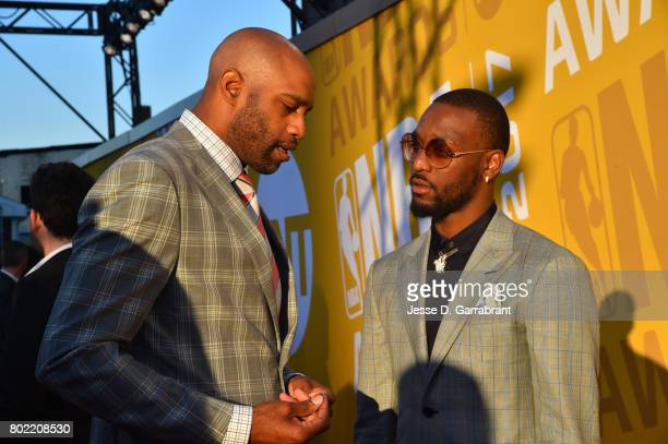 Vince Carter chats with Kemba Walker as they arrive on the red carpet during the 2017 NBA Awards Show on June 26 2017 at Basketball City in New York...